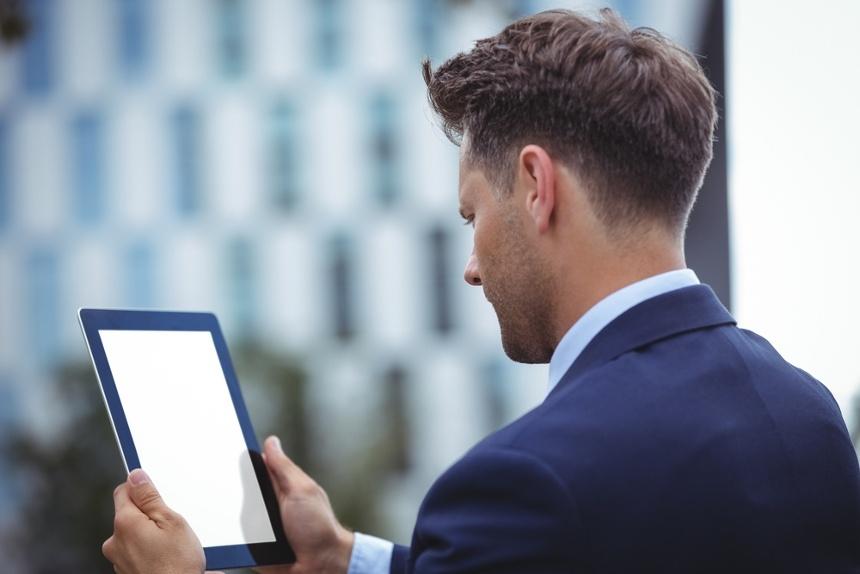 Close-up of businessman using digital tablet